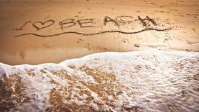 J'aime la plage sur la plage Photo libre de droits