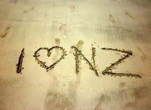 J'aime le ` du Nouvelle-Zélande de ` de NZ écrit sur le sable Photographie stock libre de droits