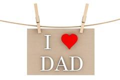 J'aime le papa avec le coeur accrochant avec des pinces à linge Photographie stock libre de droits