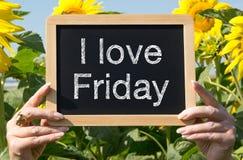 J'aime le signe et les tournesols de vendredi Image stock