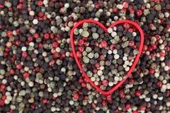 J'aime les grains de poivre mélangés Images stock