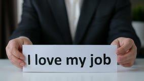 J'aime mon Job Concept Mains d'homme d'affaires tenant un papier avec le texte Fin vers le haut clips vidéos