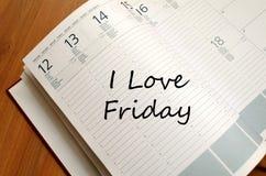 J'aime vendredi écris sur le carnet Photographie stock