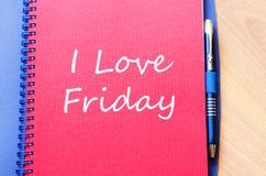 J'aime vendredi écris sur le carnet Photos stock