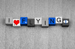 J'aime voler, signe pour le vol, le voyage et les avions ! Photos libres de droits