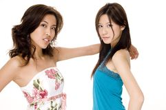 J and G #2. Two beautiful young asian women in casual clothes on white background Royalty Free Stock Images
