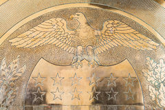 10-J Gold Seal at United States Federal Reserve. 10-J Gold Symbol Seal embedded in a wall inside the United States Federal Reserve Bank. Taken on June 24, 2014 Royalty Free Stock Photos