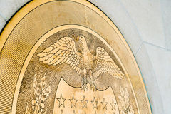 10-J Gold Seal at United States Federal Reserve. 10-J Gold Symbol Seal embedded in a wall inside the United States Federal Reserve Bank. Taken on June 24, 2014 Royalty Free Stock Photo