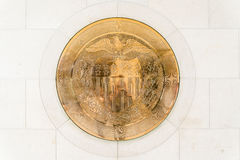 10-J Gold Seal at United States Federal Reserve. 10-J Gold Symbol Seal embedded in a wall inside the United States Federal Reserve Bank. Taken on June 24, 2014 Royalty Free Stock Images