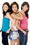 J,J and G #2. Three attractive young asian women in casual dress on white background Royalty Free Stock Photo