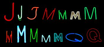 J M Q Neon Letters Royalty Free Stock Photos