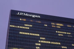 J.P.Morgan. J.P. Morgan logo and firm on a Canary Wharf office building in London, UK stock photography