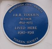 J.R.R. Tolkien blue plaque in Birmingham, England. J.R.R. Tolkien grew up in the suburbs of Birmingham. This Plaque is found in Highfield Road, Edgbaston, in stock photo