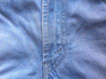 J stitch on jeans. J stitch on light blue color jeans stock photos