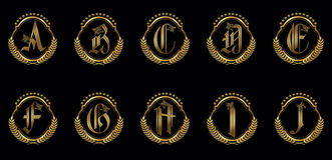 A-J utsmyckat alfabet Arkivbild