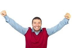 Ja! Ich tat es! Aufgeregter Mann mit den Armen oben Stockbilder