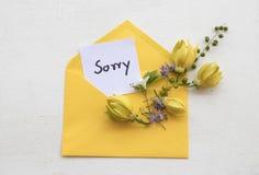 Ja jestem zmartwionym wiadomości karty handwriting z ylang kwiatem fotografia royalty free
