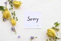 Ja jestem zmartwionym wiadomości karty handwriting z ylang kwiatem obrazy royalty free