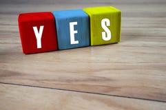 JA Wort im unterschiedlichen Farbblock für Inspirationsmotivation Lizenzfreies Stockfoto