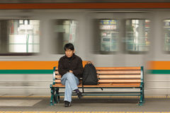 Free Jaanese Man Waiting Trin In Station Royalty Free Stock Photography - 68280657