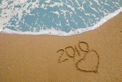 Jaar 2010 geschreven op zand Royalty-vrije Stock Foto