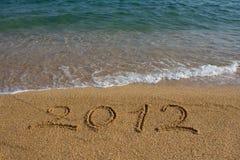 Jaar 2012 geschreven op het zand Royalty-vrije Stock Afbeeldingen