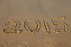 Jaar 2015 aantal op zandig strand Stock Foto's