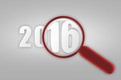 Jaar 2016 en rood vergrootglas Stock Foto