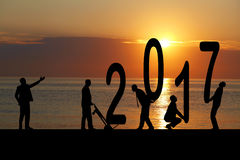 2017 jaar en silhouetmens Stock Foto's