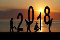 2018 jaar en silhouetmens Stock Afbeeldingen