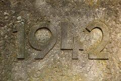 Jaar 1942 gesneden in steen De jaren van Wereldoorlog II Stock Afbeeldingen