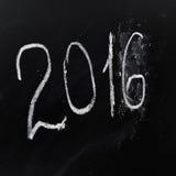 Jaar nummer 2016 geschreven op de raad Stock Foto's