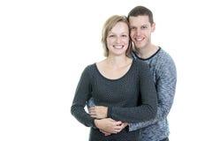 30 jaar oud paar in studiowit Royalty-vrije Stock Foto's