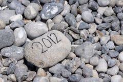 Jaar van 2012 op flintstone langs de kust Royalty-vrije Stock Afbeeldingen