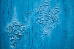 Jaarringen in een oude gebarsten blauwe verf abstracte achtergrond stock fotografie