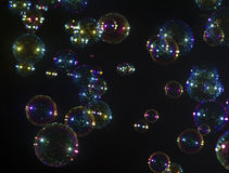 Jabón de la burbuja sobre negro Fotografía de archivo