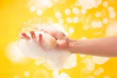 Jabón en mano femenina Fotos de archivo