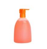 Jabón líquido anaranjado aislado fotografía de archivo