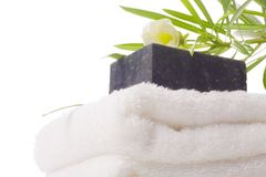 Jabón negro con la toalla Foto de archivo libre de regalías