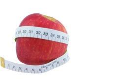 Jabłczana Czerwona miara wokoło talii Odizolowywającej na białym tle Obrazy Royalty Free