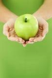 jabłczane ręki obraz royalty free
