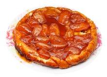 Jabłczanego kulebiaka tarte Tatin na talerzu odizolowywającym zdjęcie royalty free