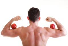 jabłczanego sportowego ciała budowniczego mienia męski czerwony seksowny Fotografia Stock