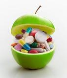 Jabłczany pełny medycyny zdjęcie royalty free