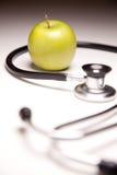 jabłczany tło gradated zielony stetoskop zdjęcie royalty free