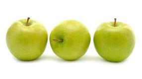 jabłek tła zieleni trzy biel Zdjęcie Royalty Free
