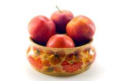 jabłka rozdają drewnianego Obrazy Royalty Free