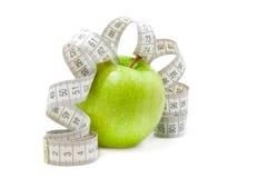 jabłko - obrazek taśmy zielona miara Fotografia Stock