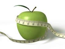 jabłko wokoło zielonej miary taśmy zawijającej Obraz Royalty Free