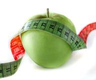 jabłko - zielona pomiarowa taśma Obraz Royalty Free